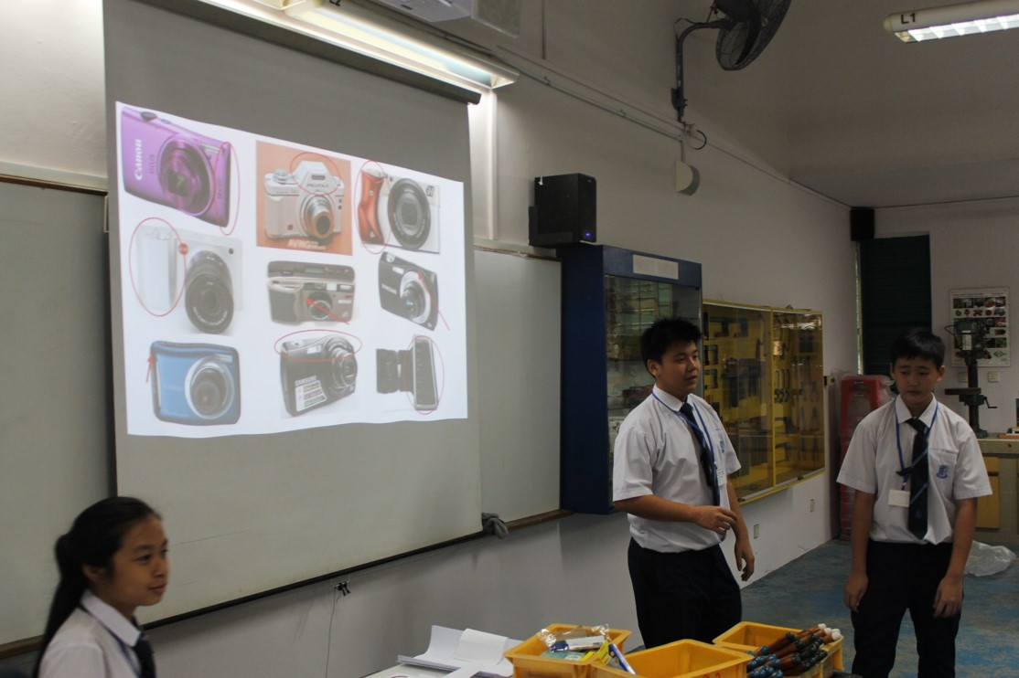 Students presenting on design of cameras